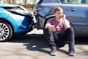 driver-making-phone-call-after-traffic-accident