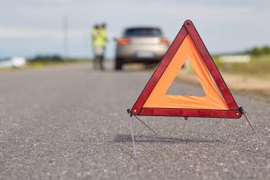 orange safety triangle on the road