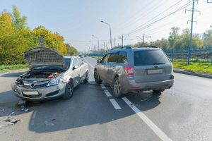 two cars on the road after an accident